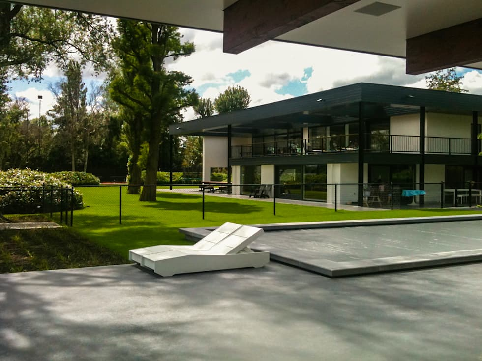 Foto s van een minimalistische tuin familietuin homify