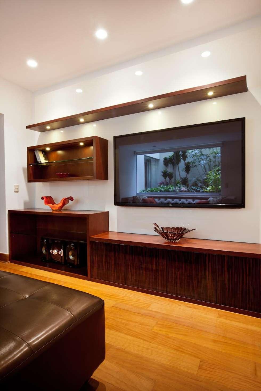 Sala de entretenimiento: Salas / recibidores de estilo ecléctico por Carughi Studio