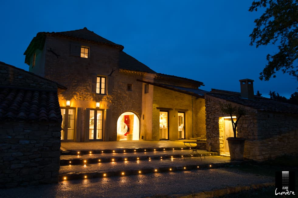 Façade en pierre: Maisons de style de style Rustique par Jeux de Lumière