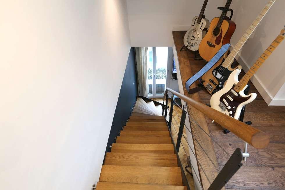 Nos dernières réalisations: Couloir et hall d'entrée de style  par Passion Bois