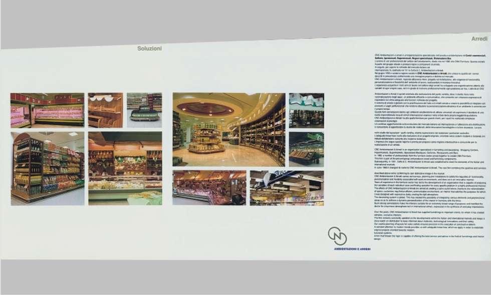 bettini designer bologna: Spazi commerciali in stile  di bettini design