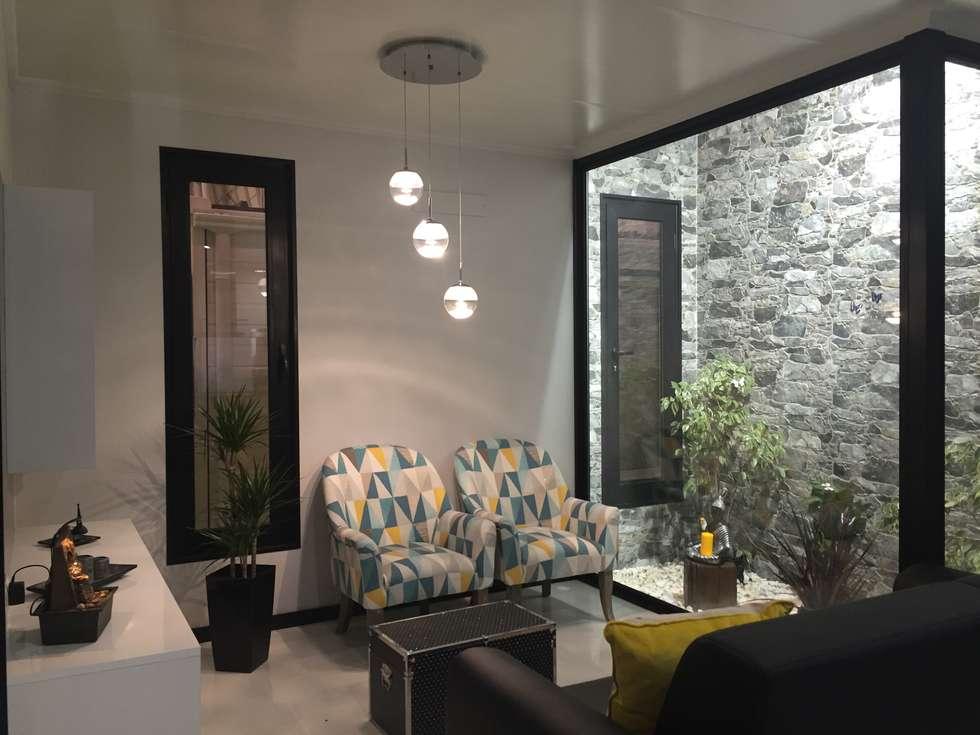 Sala kitur: Salas de estar minimalistas por KITUR