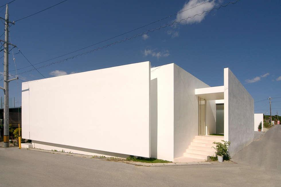 Casas de estilo minimalista por 門一級建築士事務所