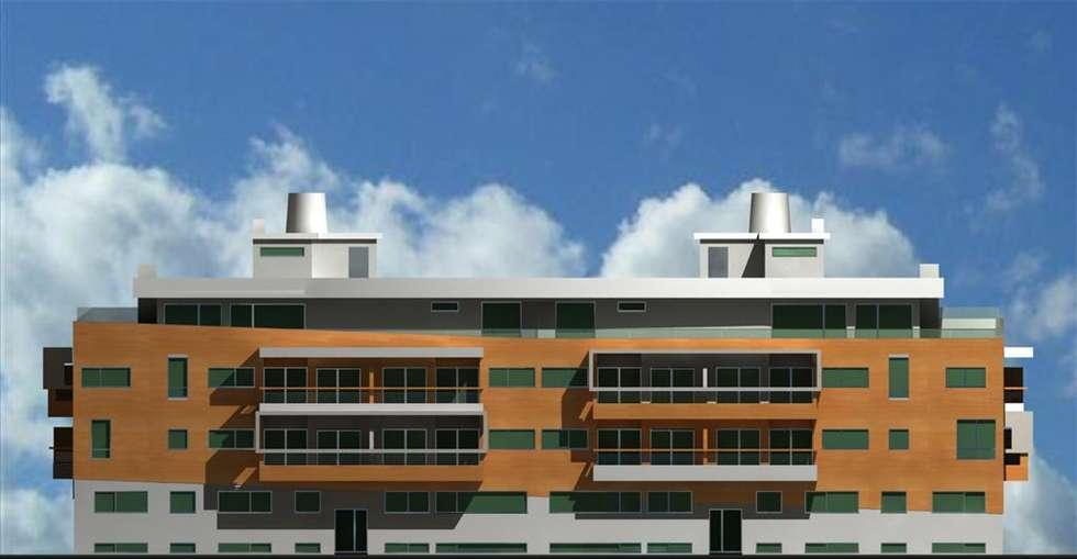 Edifício Praia Oeste - Praia da Barra Ilhavo: Casas modernas por José Vitória Arquitectura