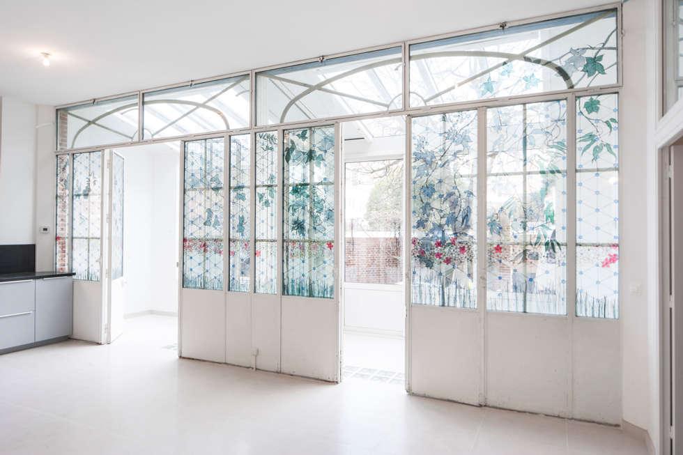 Fenêtres existantes conservées: Salon de style de style Industriel par Olivier Olindo Architecte
