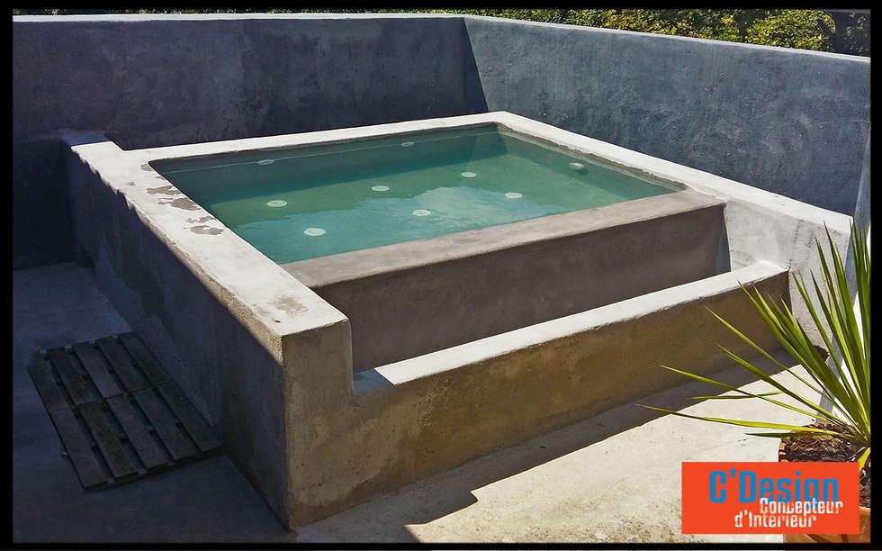 Bassin bouillonnant à débordement sur une terrasse: Spa de style de style eclectique par C'Design