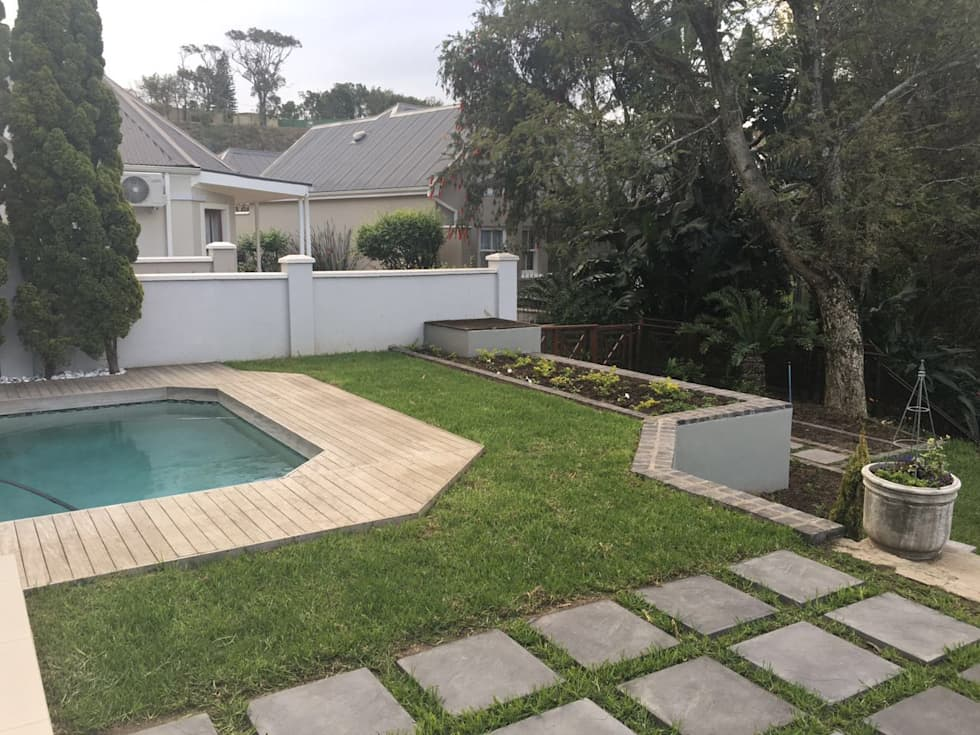 After picture of new lawn and paving near the pool.: minimalistic Garden by Helen Sparg Landscape Designer
