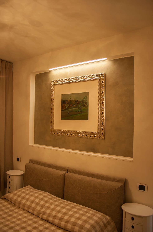 Casa di campagna a Misano Adriatico.: Camera da letto in stile in stile Rustico di Architettura & Interior Design 'Officina Archetipo'
