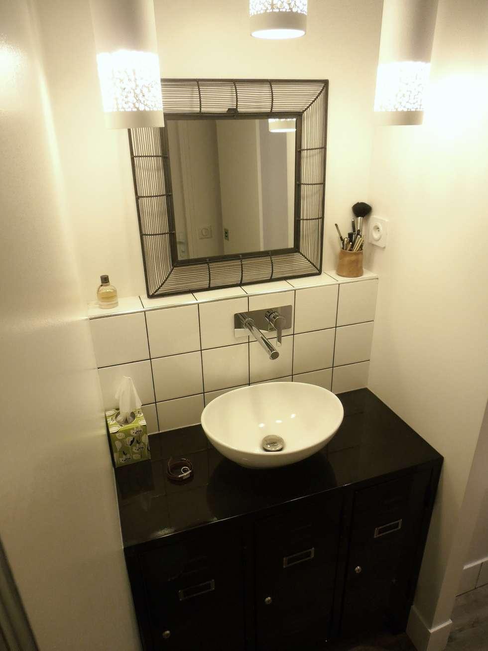 la salle de bains: Salle de bains de style  par espaces & déco
