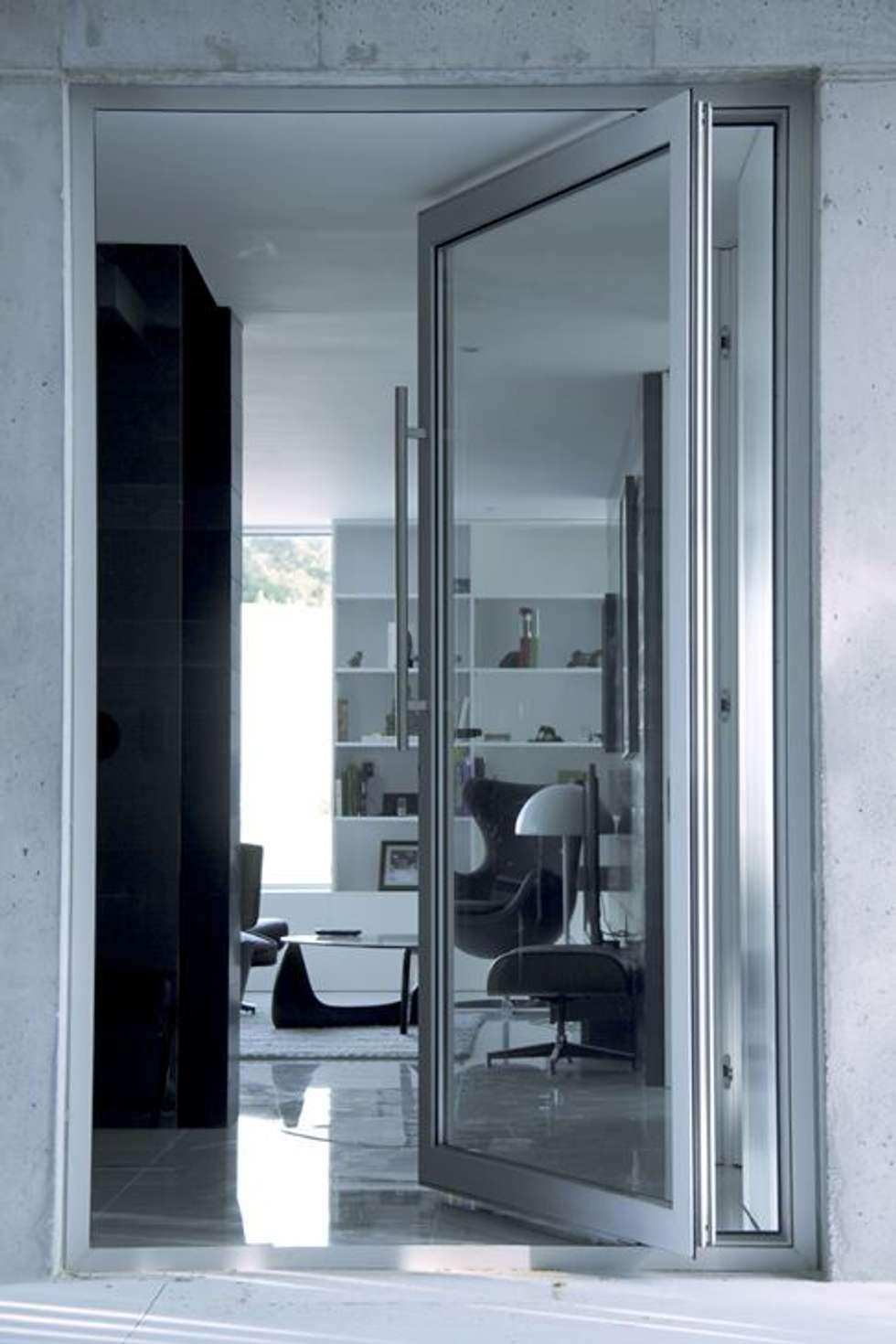 Casa Claudia: Salas de estar minimalistas por Artspazios, arquitectos e designers