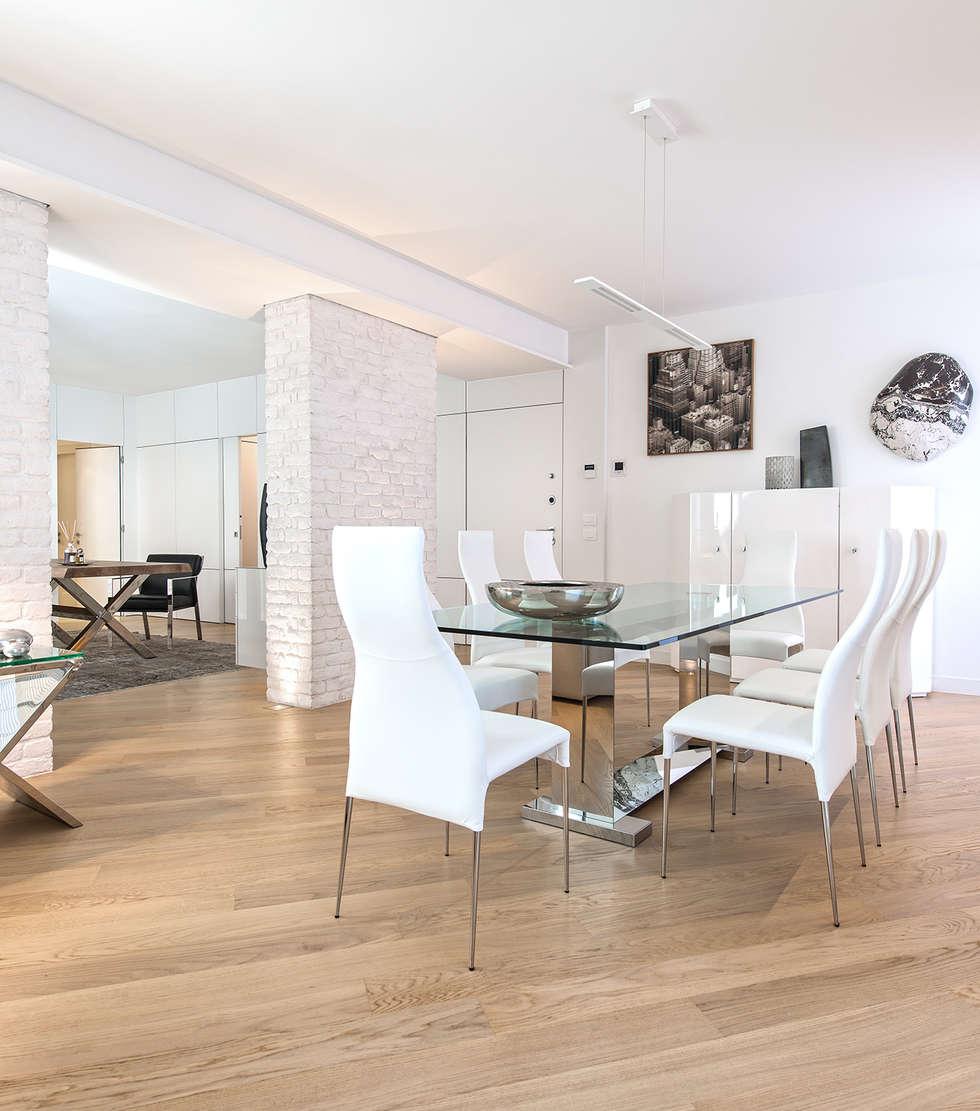 Minimal white sala da pranzo in stile in stile moderno di for Arredamento moderno minimal