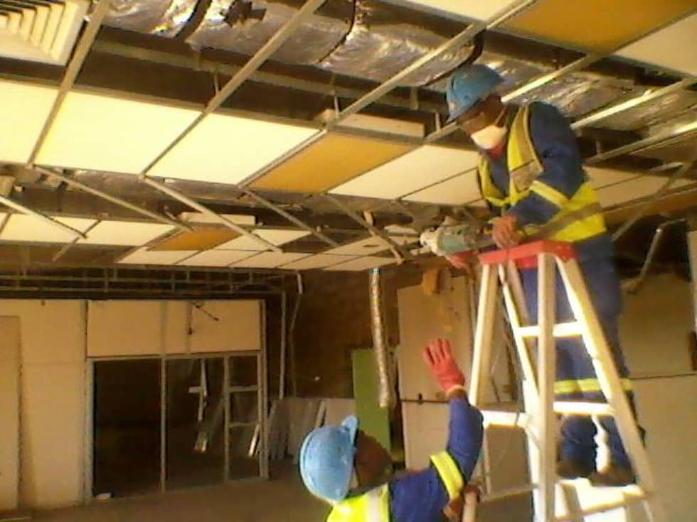 Fixing and Painting of the ceiling: industrial Living room by Nozipho Construction