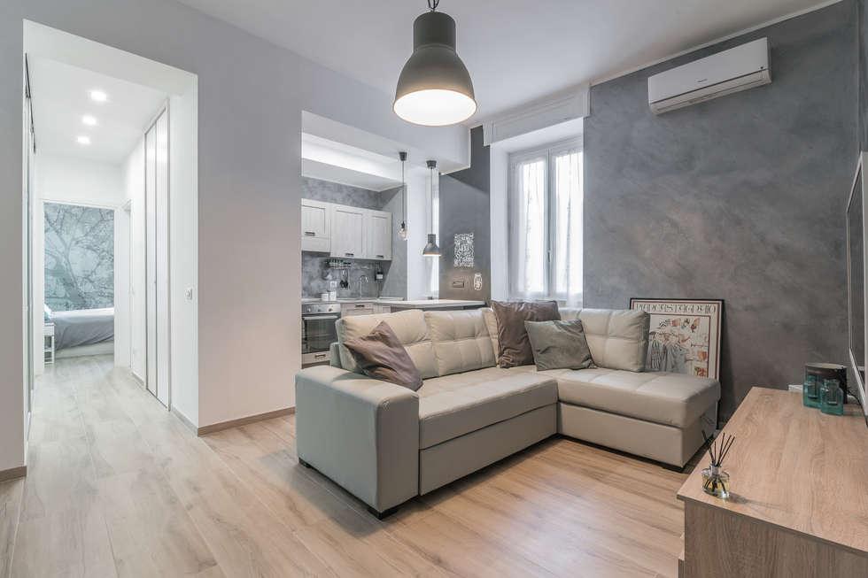 Open space soggiorno in stile in stile moderno di facile for Open space moderni