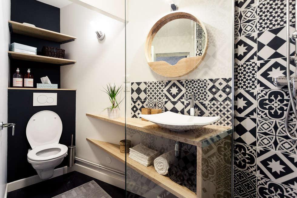 Rénovation complète d'un appartement de 30m²: Salle de bains de style  par MadaM Architecture