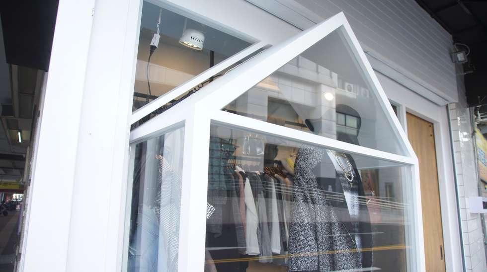 韓系街邊服飾小店:  辦公室&店面 by 光島室內設計