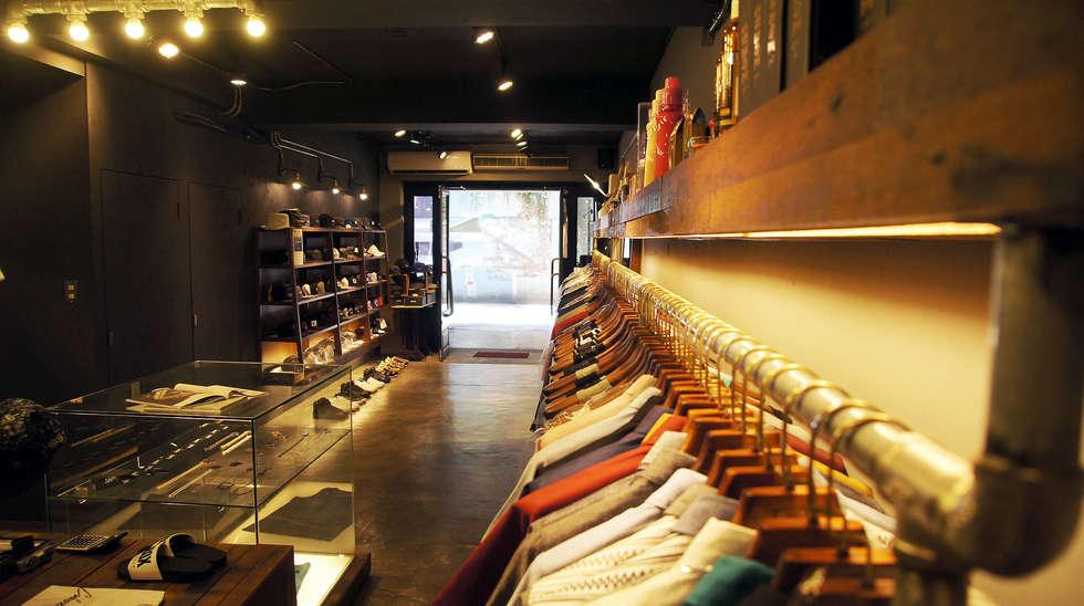英式紳士風格商業空間:  展覽中心 by 光島室內設計