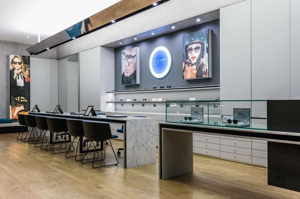 1: Lojas e espaços comerciais  por XYZ Arquitectos Associados