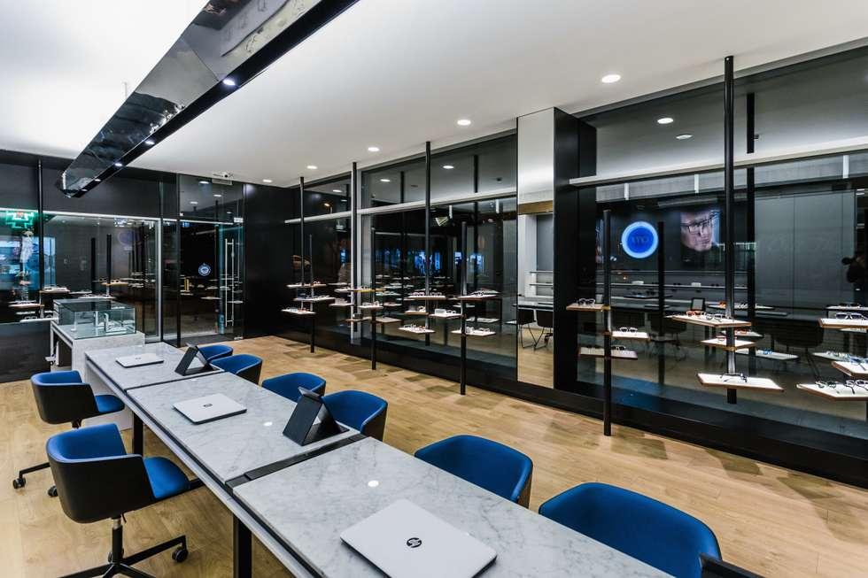 11: Lojas e espaços comerciais  por XYZ Arquitectos Associados