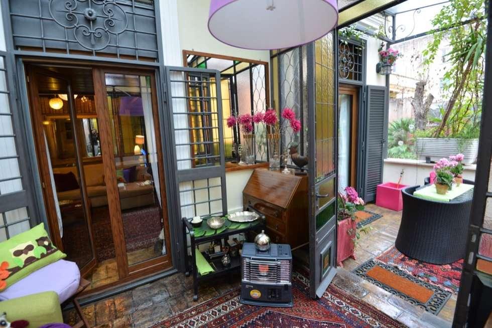La veranda: Ingresso & Corridoio in stile  di Studio Fori