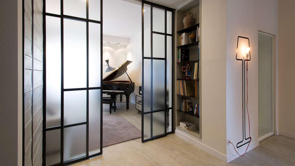 Appartamento al Gazometro: Soggiorno in stile in stile Industriale di Archifacturing