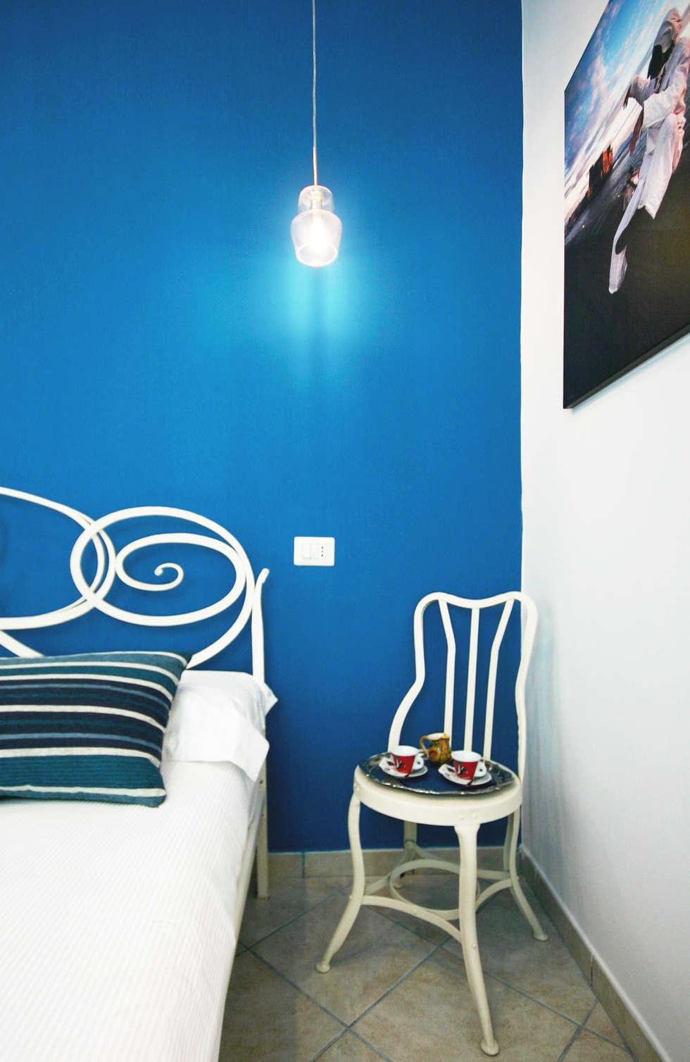 Camera letto - Particolare: Ingresso & Corridoio in stile  di archielle