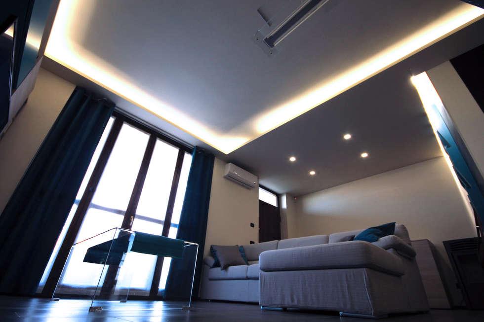 living: Soggiorno in stile in stile Moderno di FLAPstudio   ArchitecturalDesignLAB