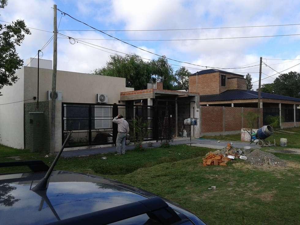 Etapa de construcción - Losa: Casas de estilo minimalista por De Signo +