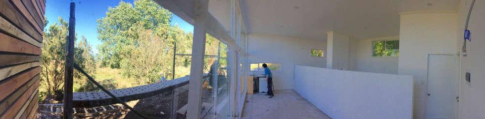 Interior tipo loft.: Casas de estilo moderno por Cordova Arquitectura y Construcción .