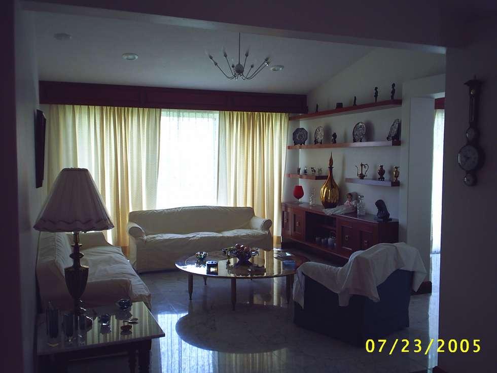CASA WILMA : Salas de estilo clásico por SG Huerta Arquitecto Cancun