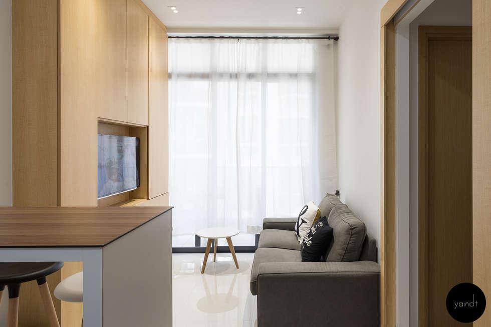 Living Area: scandinavian Living room by Y&T Pte Ltd