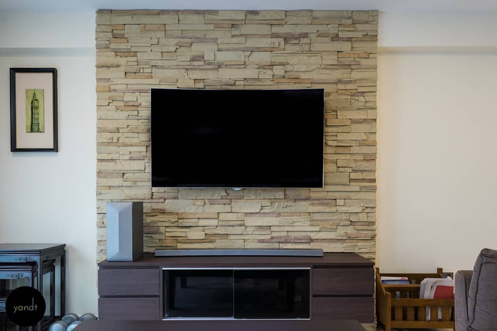 TV console and feature wall: asian Living room by Y&T Pte Ltd