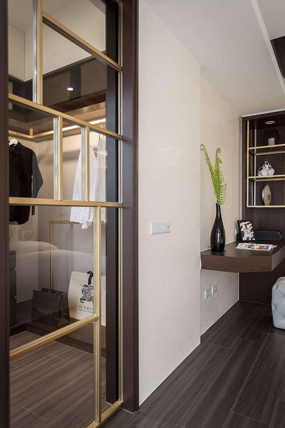 主臥馬來漆牆面:  臥室 by 你你空間設計