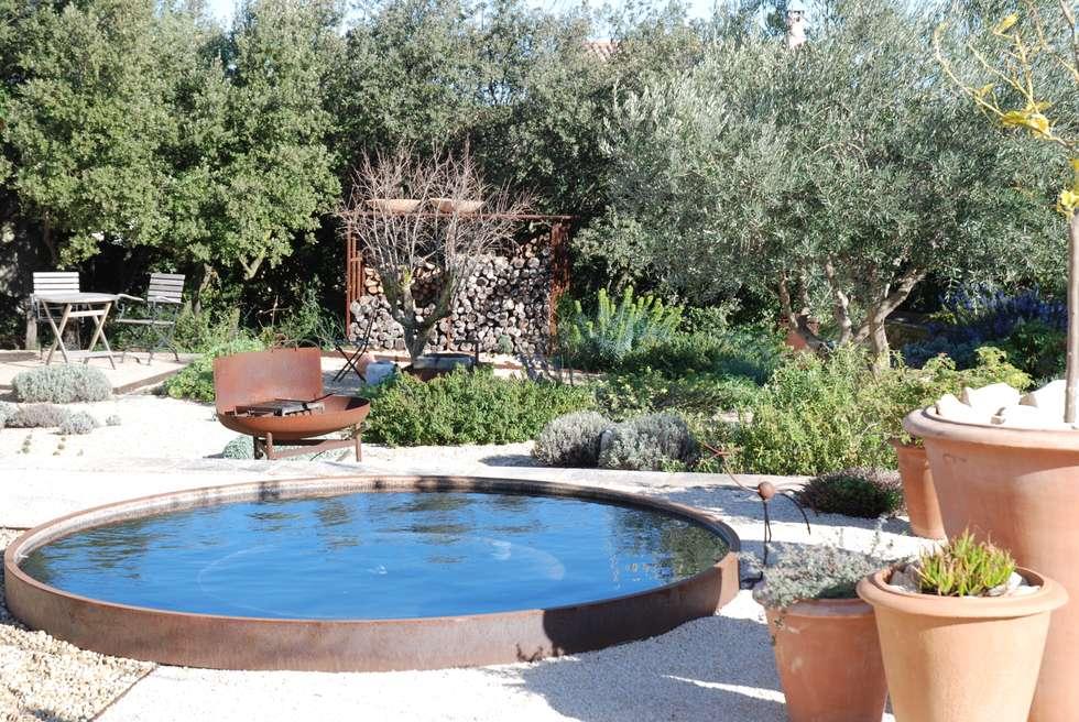 DES STRUCTURES EN METAL: Jardin de style de style Méditerranéen par JARDIN GECKO