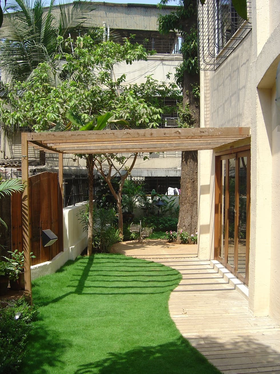 Garden Landscape For Bungalow At Chembur Tropical By Land Design Architects
