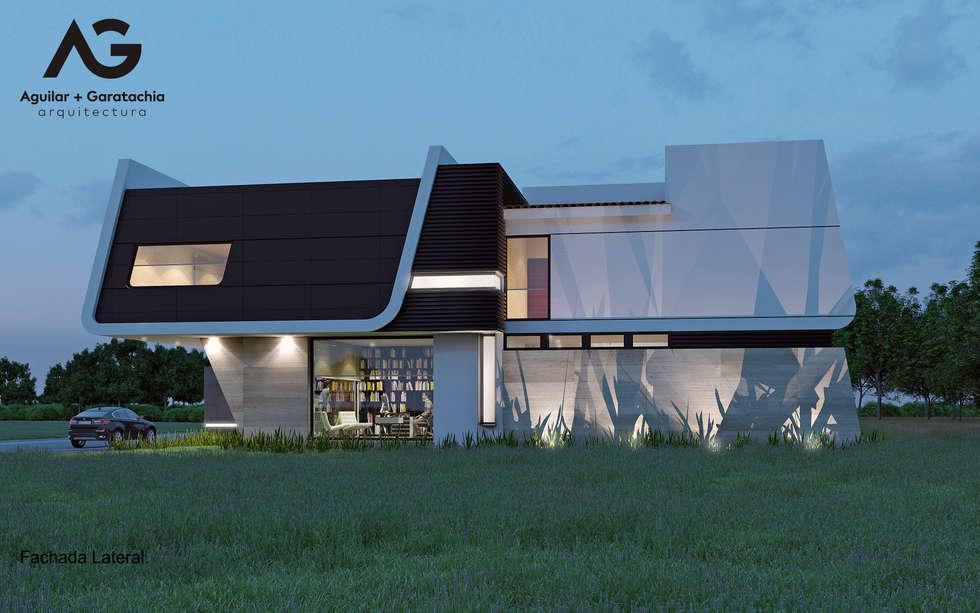 Fachada latera: Casas de estilo moderno por Aguilar + Gartachia arquitectura