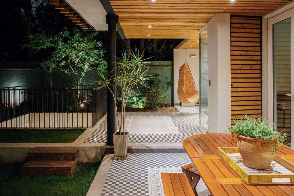 Vista quincho y terraza cubierta terrazas de estilo por thomas l wenstein arquitecto homify - Cubierta para terraza ...