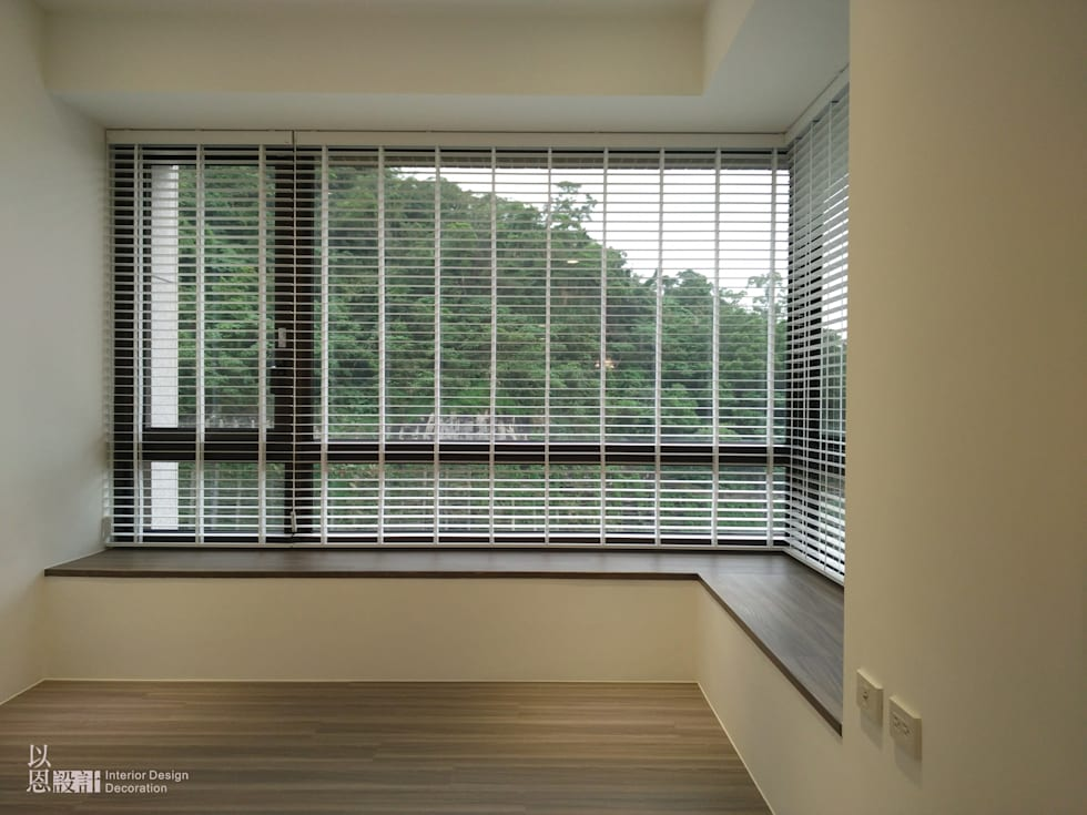 架高木地板休閒區:  臥室 by 以恩設計