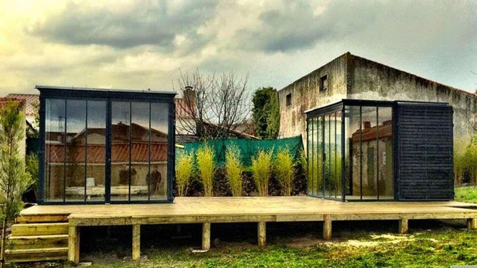 Un CUBE dans mon jardin : Chambre de style de style Moderne par Tabary Le Lay