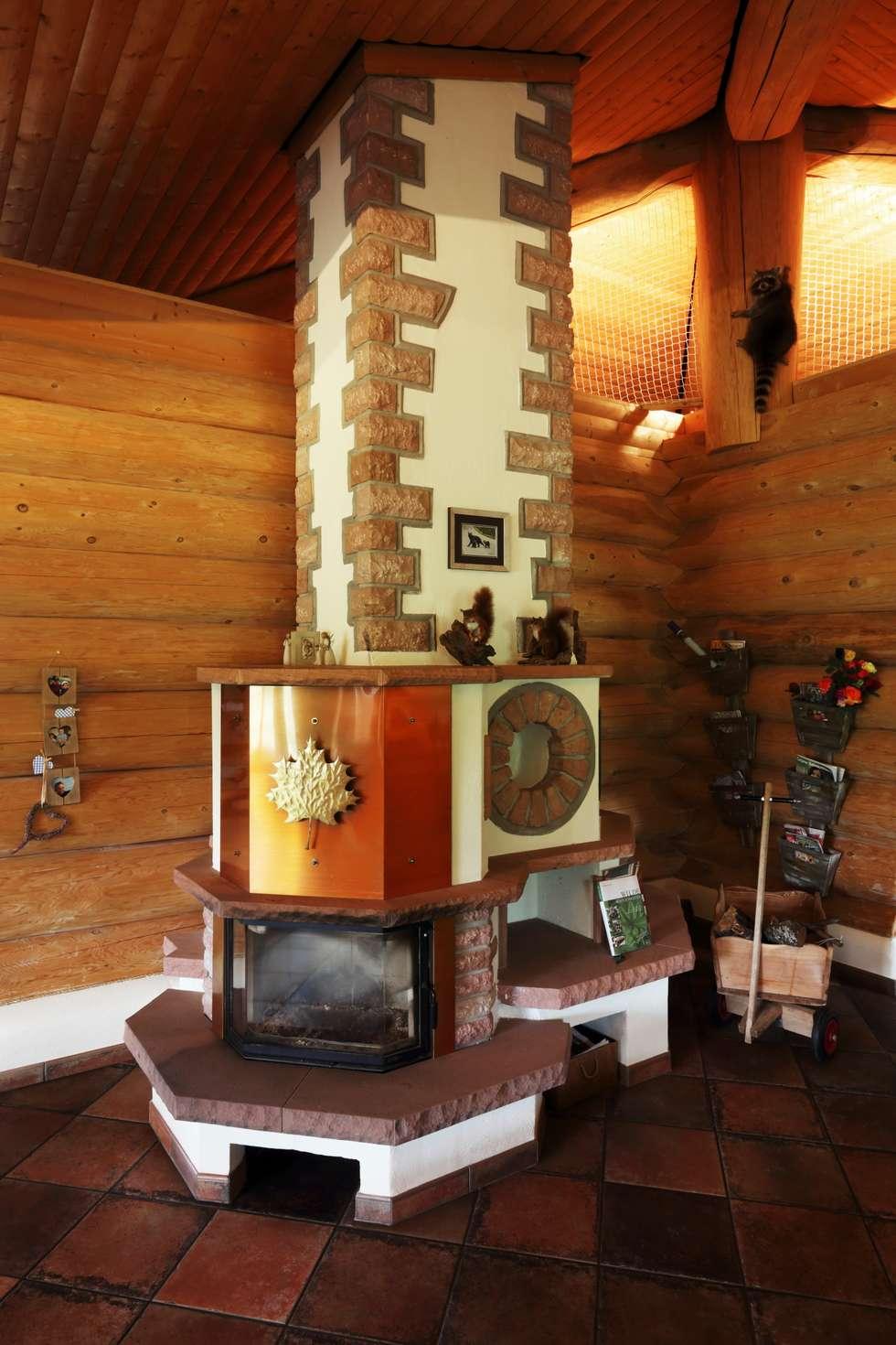 Haus racoon hill: rustikale wohnzimmer von das holzhaus oliver ...