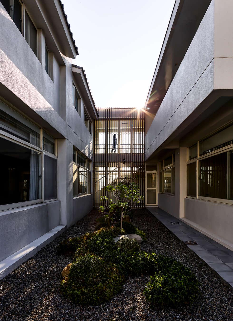 Glocal Architecture Office (G.A.O) 吳宗憲建築師事務所/安藤國際室內裝修工程有限公司의  정원