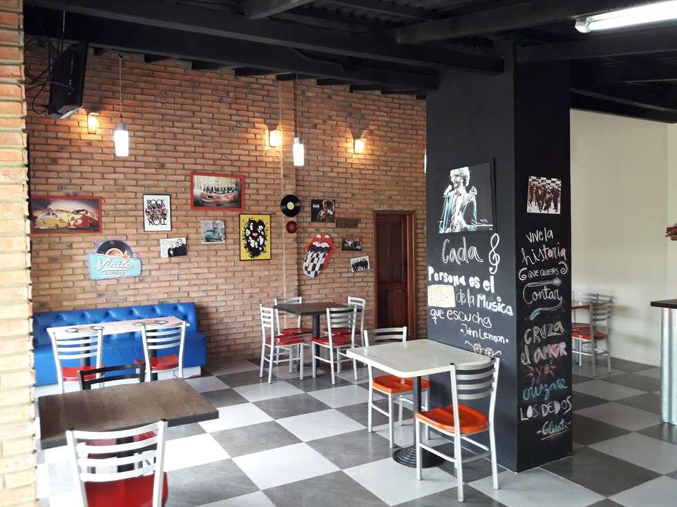 Elementos Decorativos Internos: Restaurantes de estilo  por Arq. Alberto Quero