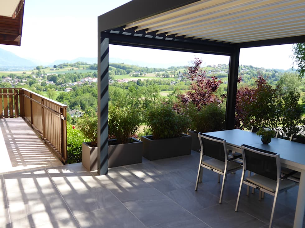 Une pergola bioclimatique pour protéger des aléas climatiques: Jardin de style de style Moderne par Berger Jardins