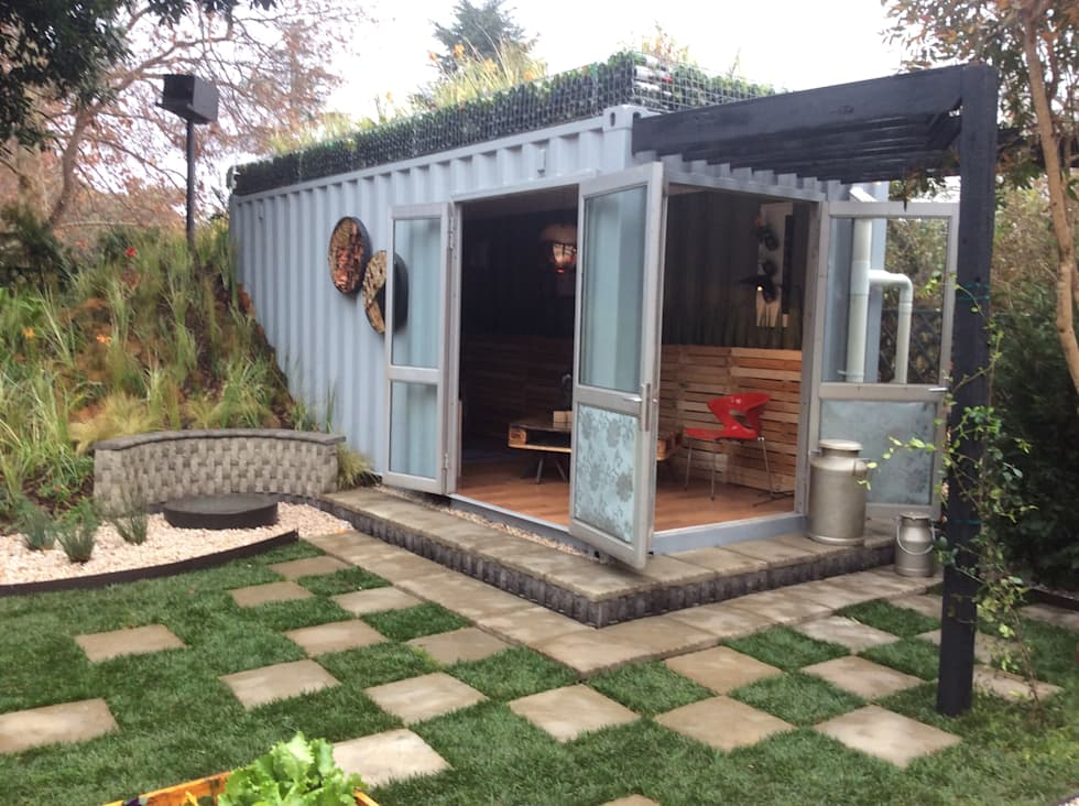 container living with recycled materials merged into the garden industrial houses by acton gardens