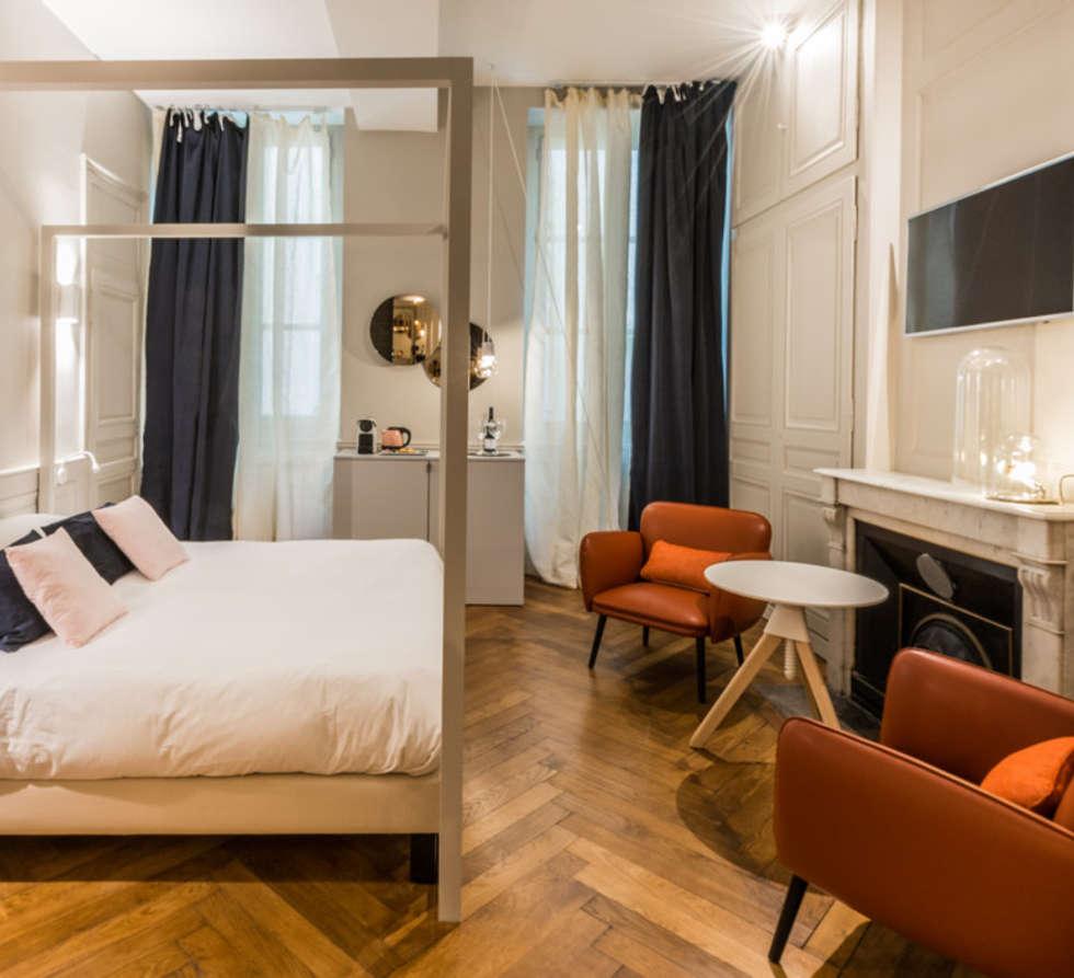 Eclairage Chambre de l'hôtel: Hôtels de style  par NEDGIS