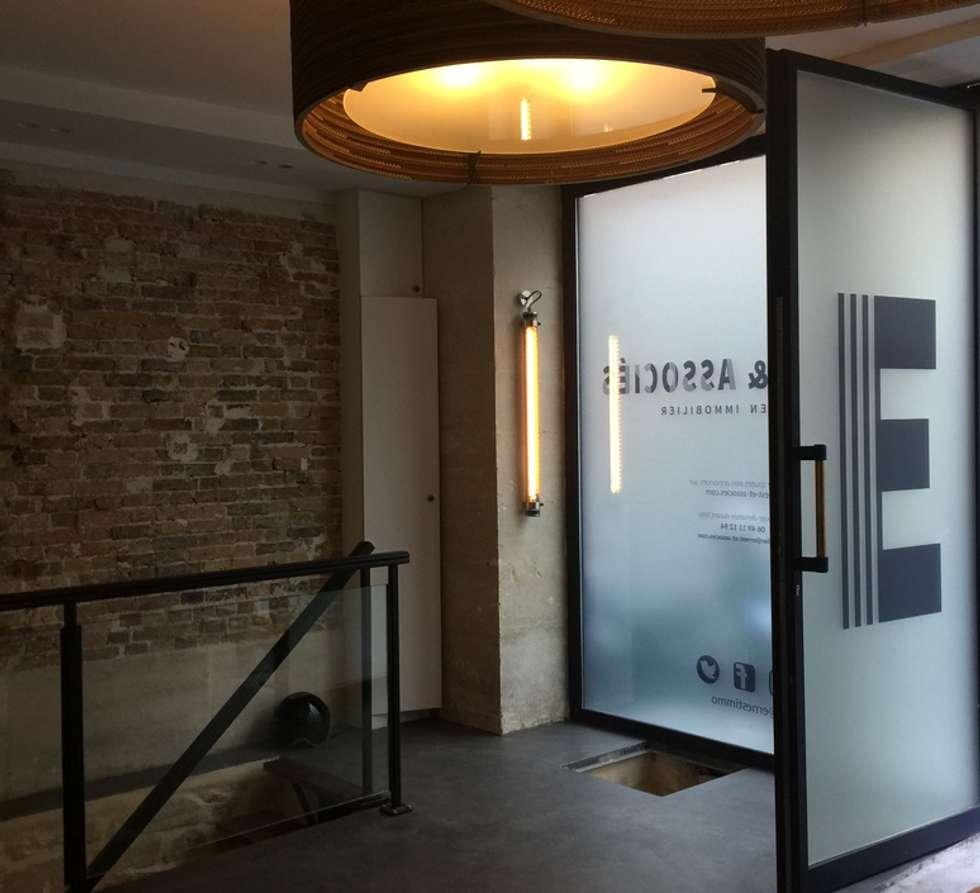 AGENCE IMMOBILIÈRE ERNEST & ASSOCIÉS, Paris: Espaces commerciaux de style  par NEDGIS