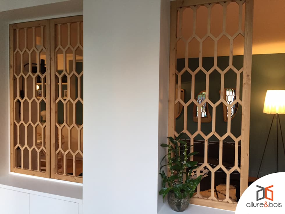 Claustra Apicula: Salle à manger de style de style Moderne par Allure et Bois