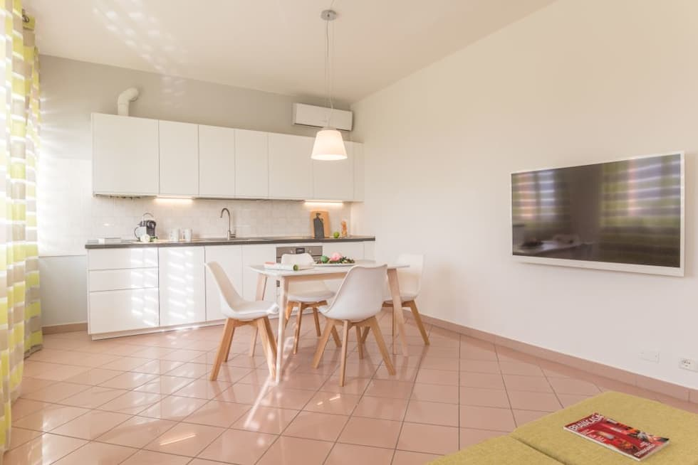 Airone, Home Staging per la Microricettività: Sala da pranzo in stile in stile Minimalista di Anna Leone Architetto Home Stager