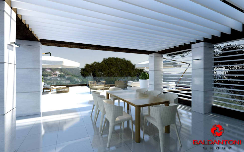 Sala da pranzo con terrazza esterna: Sala da pranzo in stile in stile Moderno di Baldantoni Group