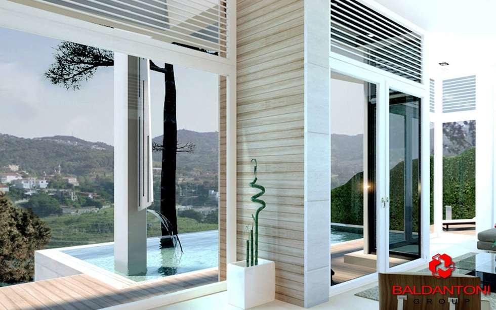 Finestre nel soggiorno con vista panoramica: Finestre in stile  di Baldantoni Group