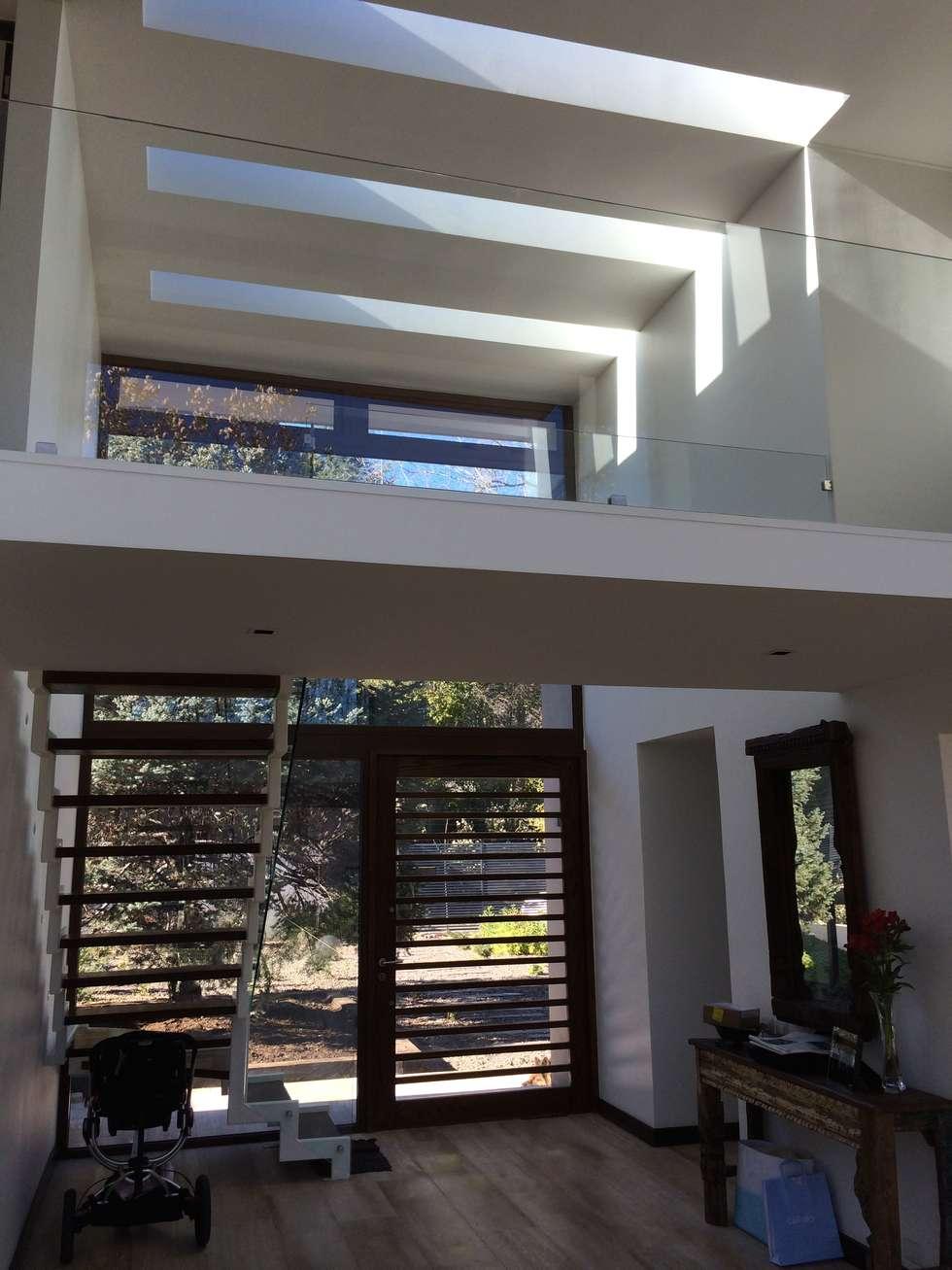 CASA UNIFAMILIAR : Casas unifamiliares de estilo  por PICHARA + RIOS arquitectos
